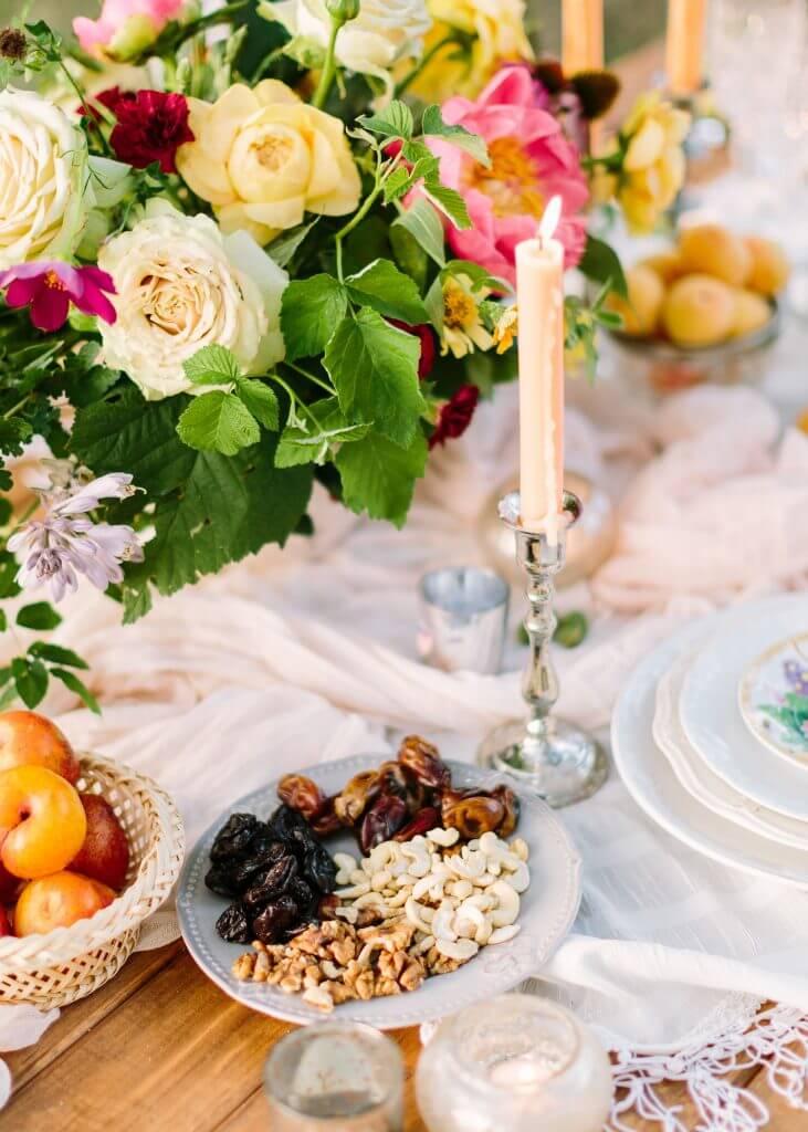 Organic peach destination wedding pic table detail