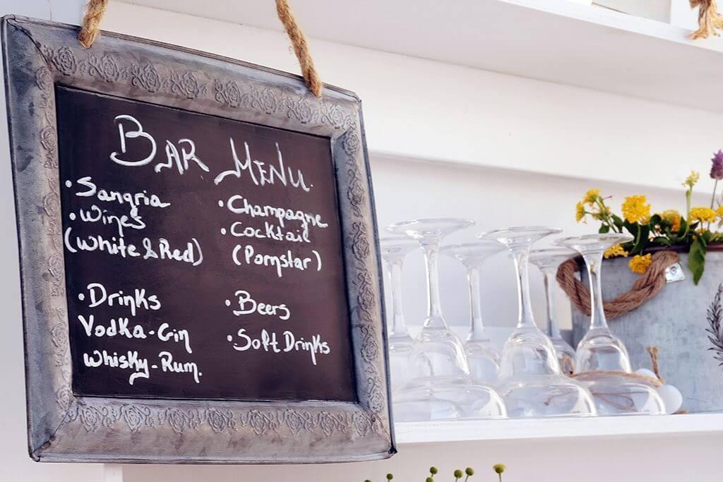 Destination wedding in island paros Bar sign