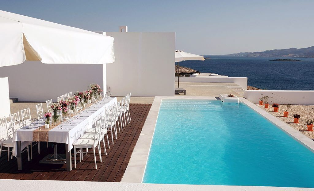 Destination wedding in island paros table by the pool