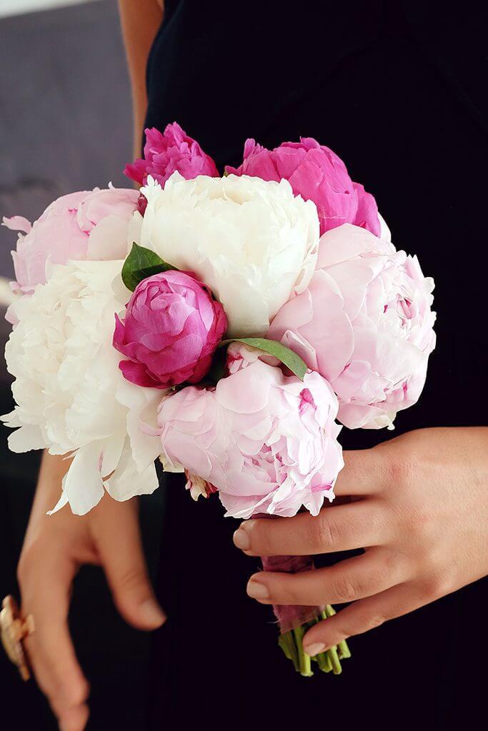 Destination wedding in island paros peonies white pink bouquet