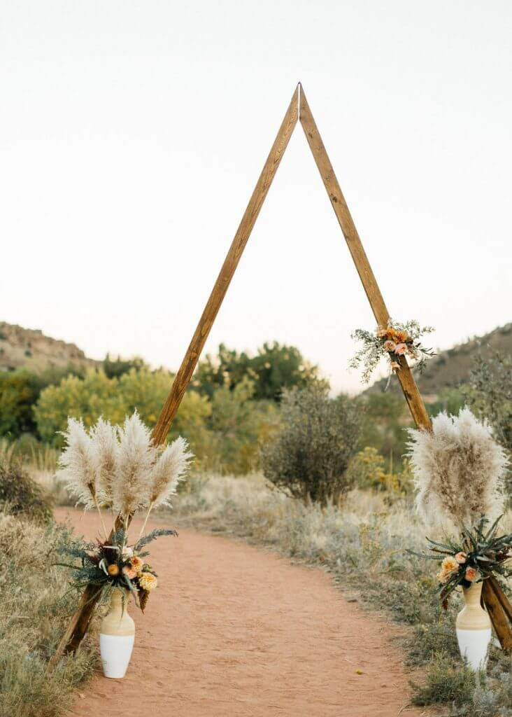 triangle wedding arch make happy memories